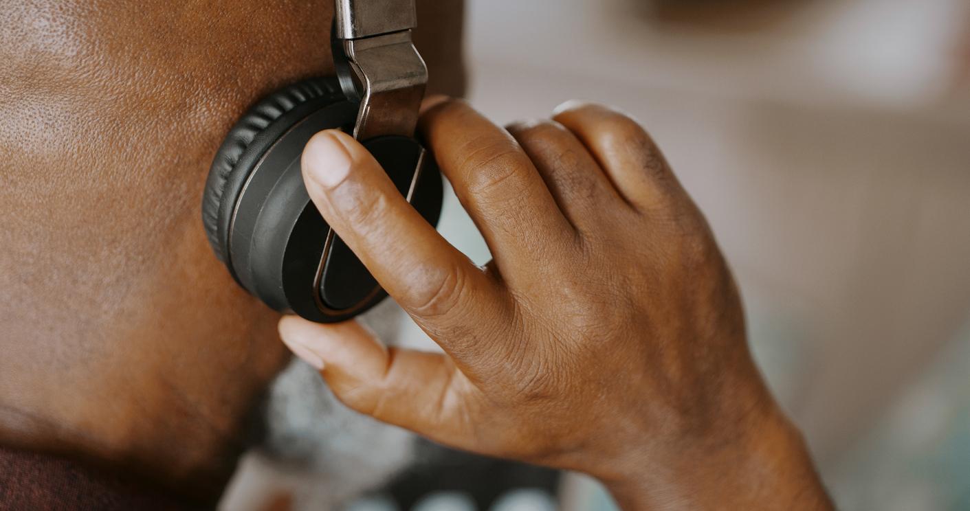 Man listening through headphones